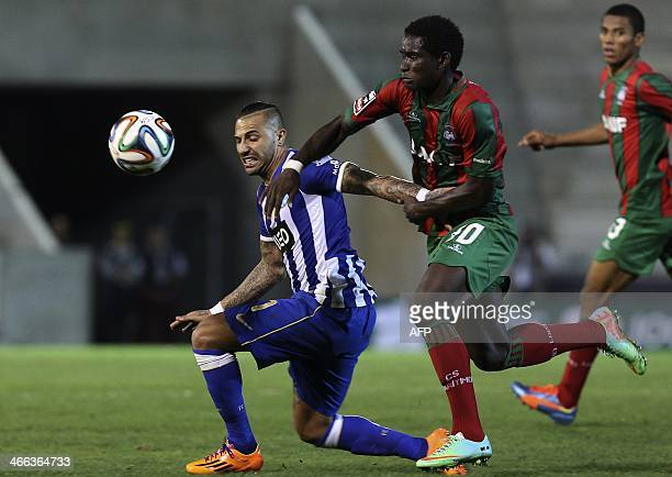 Porto's forward Ricardo Quaresma vies with Maritimo's Liberian midfielder Theo Weeks during the Portuguese league football match CS Maritimo vs FC...