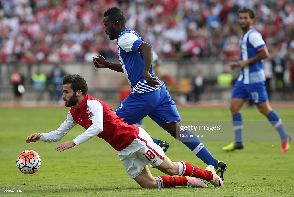 FC Porto's forward Silvestre Varela (R) tackles SC Braga's forward Rafa Silva (L) during the Portuguese Cup Final match between FC Porto and SC Braga at Estadio Nacional on May 22, 2016 in Lisbon, Portugal.
