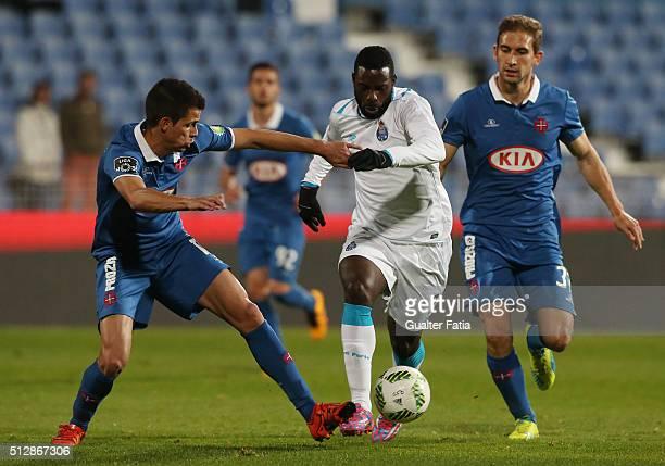 Porto's forward Silvestre Varela with Os Belenenses' defender Andre Geraldes and Os Belenenses' defender Goncalo Silva in action during the Primeira...