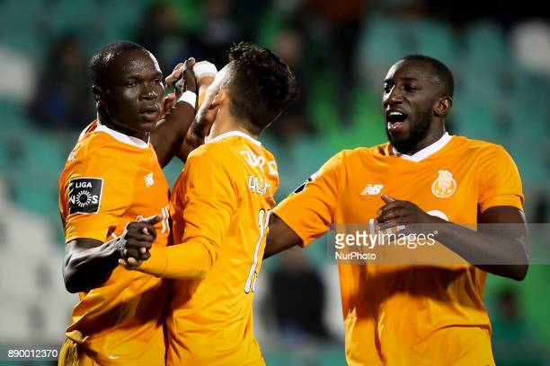 Porto's forward Vincent Aboubakar celebrates with Porto's defender Alex Telles and Porto's forward Moussa Marega after scoring during the Portuguese...