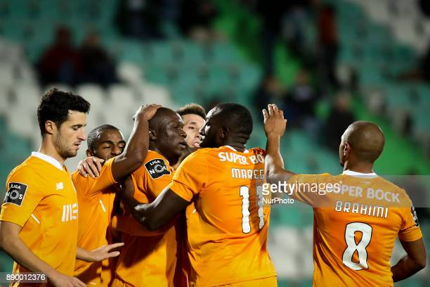 Porto's forward Vincent Aboubakar celebrates with team mates after scoring during the Portuguese League football match between Vitoria Setubal and FC...