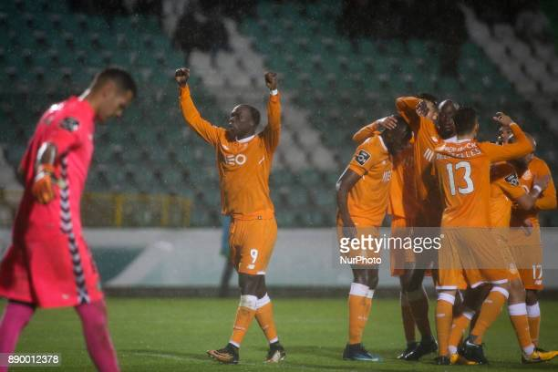 Porto's forward Vincent Aboubakar celebrates with team mates after scoing during the Portuguese League football match between Vitoria Setubal and FC...