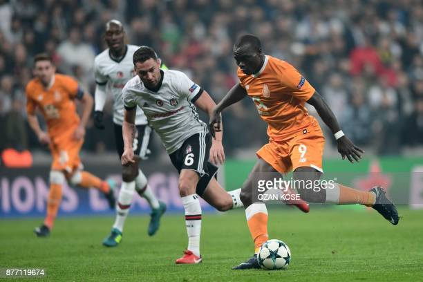 Porto's forward Vincent Aboubakar vies for the ball with Besiktas' Dusco Tosic during the UEFA Champions League Group G football match between...