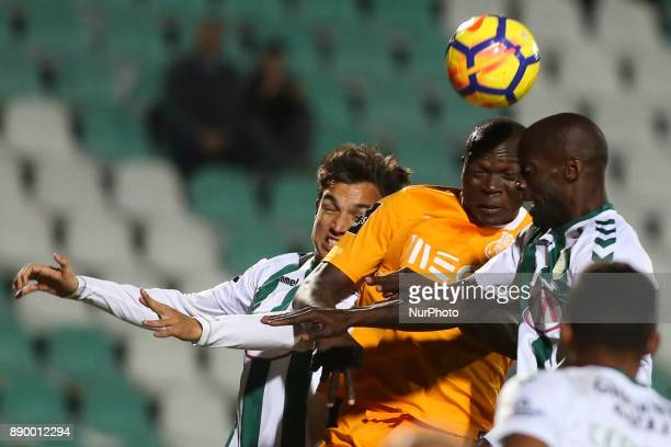 Porto's forward Vincent Aboubakar vies with Setubal's defender Nuno Pinto and Setubal's defender Tomas Podstawski during the Portuguese League...