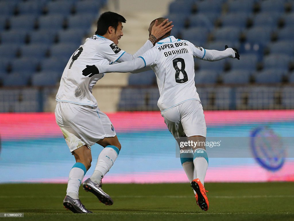 FC Porto's forward Yacine Brahimi celebrates with teammate FC Porto's forward from South Korea Suk Hyun-Jun after scoring a goal during the Primeira Liga match between Os Belenenses and FC Porto at Estadio do Restelo on February 28, 2016 in Lisbon, Portugal.