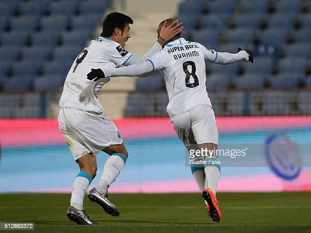 Porto's forward Yacine Brahimi celebrates with teammate FC Porto's forward from South Korea Suk HyunJun after scoring a goal during the Primeira Liga...