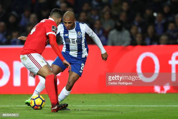PortoÕs forward Yacine Brahimi from Algeria tries to escape Benfica's defender Andre Almeida from Portugal during the FC Porto v SL Benfica Primeira...
