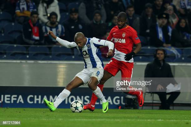Porto's forward Yacine Brahimi from Algeria tries to escape Monaco defender Almany Toure from Mali during the match between FC Porto v AS Monaco or...