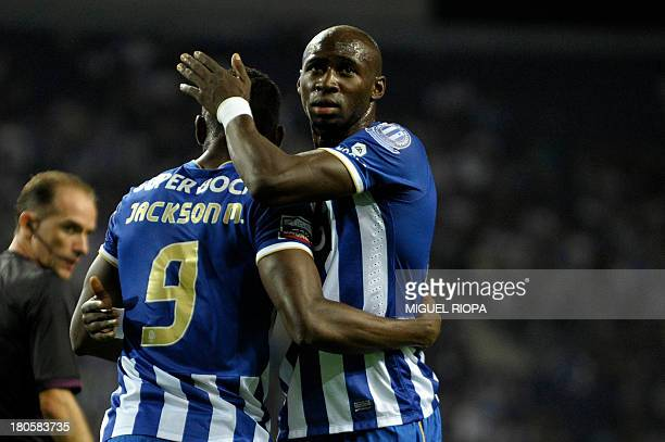Porto's French defender Eliaquim Mangala congratulates his teammate Colombian forward Jackson Martinez on scoring during the Portuguese super league...