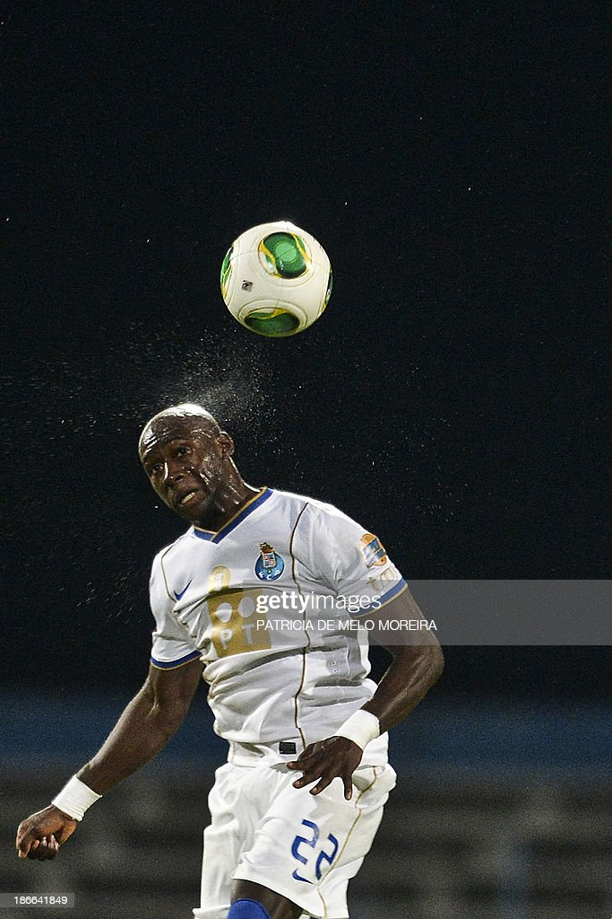 FC Porto's French defender Eliaquim Mangala heads the ball during the Portuguese league football match Belenses vs FC Porto at Restelo stadium in Lisbon on November 2, 2013. The game ended in a draw 1-1.