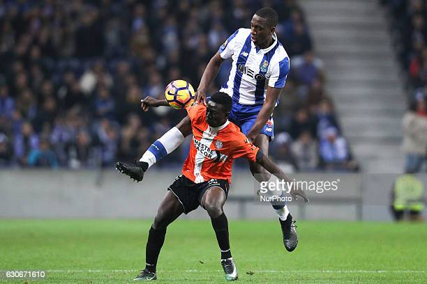 Porto's French defender Willy Boly vies with Feirense's forward Peter Etebo during the League Cup 2016/17 match between FC Porto and CD Feirense at...