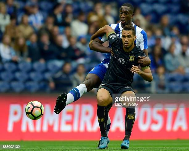 Porto's French defender Willy Boly vies with Pacos de Ferreira's Brazilian forward Luiz Phellype during the Portuguese league football match FC Porto...