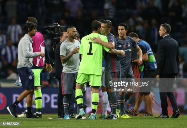 Porto's goalkeeper Iker Casillas from Spain congratulates his former Real Madrid teammate Besiktas defender Pepe from Portugal at the end of the UEFA...