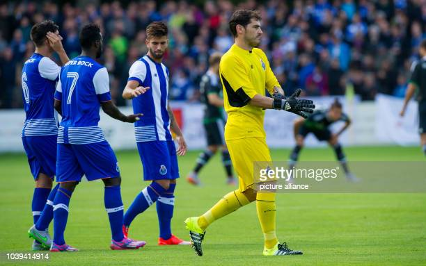 Porto's goalkeeper Iker Casillas  puts on his gloves during a friendly between German soccer club FC Schalke 04 and Portugal's FC Porto in Guetersloh...