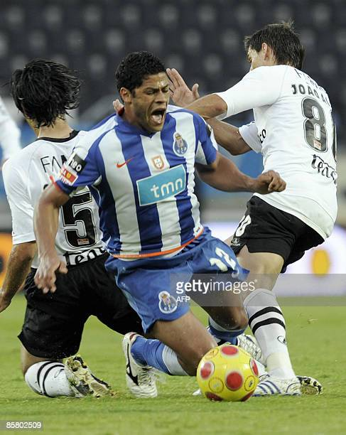 FC Porto's 'Hulk' Sousa is tackled by Vitoria de Guimaraes� Gregory and Joao Alves during their Portuguese Liga football match at Afonso Henriques...