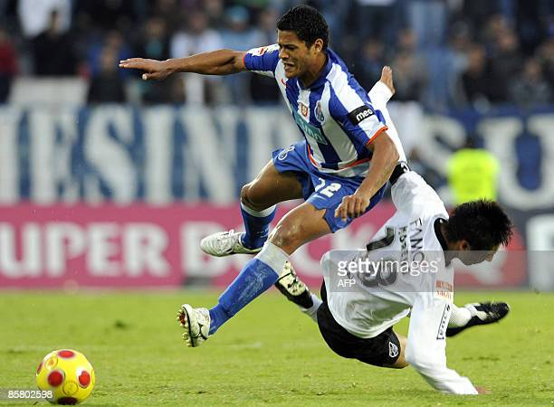 FC Porto's 'Hulk' Sousa is tackled by Vitoria de Guimaraes� Moreno during their Portuguese Liga football match at Afonso Henriques Stadium in...