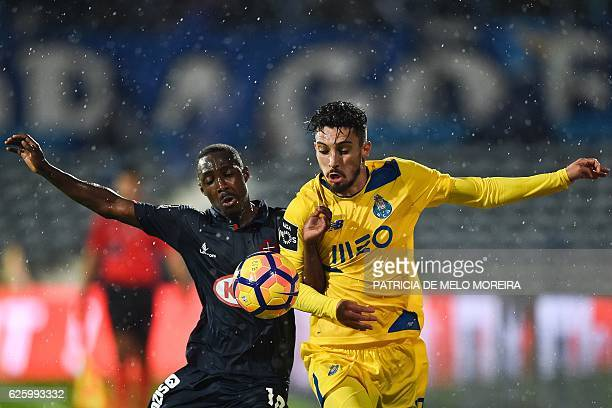 Porto's Italian defender Alex Telles vies with Belenenses' Bissau Guinean forward Gerso Fernandes during the Portuguese league football match OS...