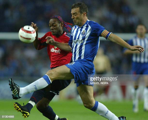 Porto's Jorge Costa fights for the ball with CSKA Moskva's Brazilian player Vagner Love during the European Champions League group H football match...