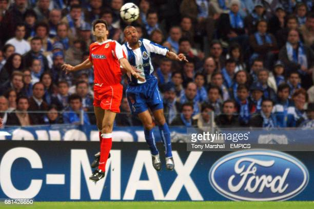 FC Porto's Juan Valeron and Deportivo La Coruna's Costinha battle for the ball in the air