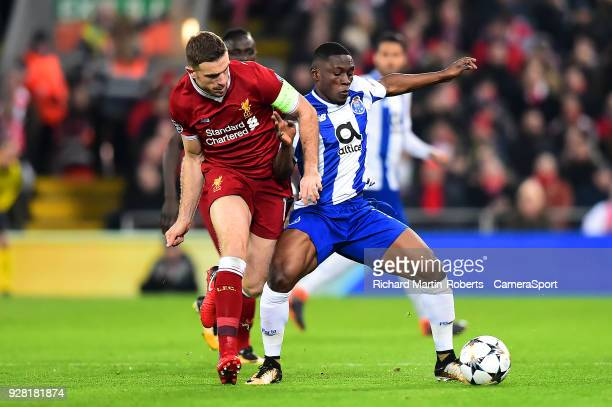 Porto's Majeed Waris vies for possession with Liverpool's Jordan Henderson during the UEFA Champions League Round of 16 Second Leg match between...