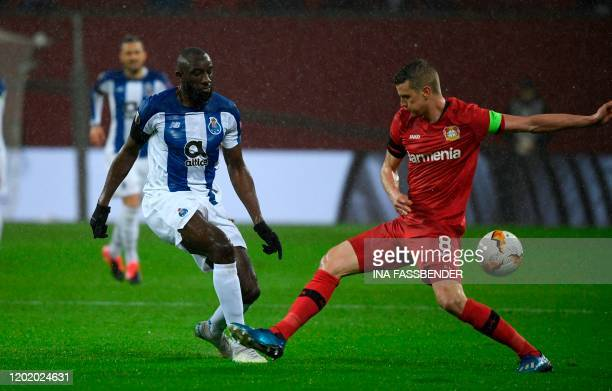 FC Porto's Malian forward Moussa Marega and Leverkusen's German midfielder Lars Bender vie for the ball during the Europa League last 32 first leg...