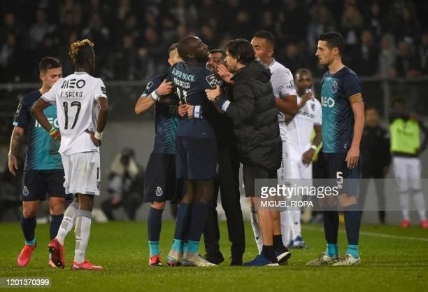 FC Porto's Malian forward Moussa Marega attempts to leave the pitch after hearing racists chants as FC Porto's Portuguese coach Sergio Conceicao...