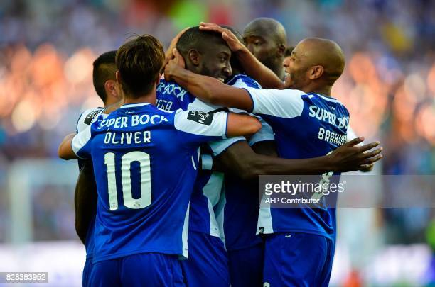 Porto's Malian forward Moussa Marega celebrates a goal with teammates during the Portuguese league football match FC Porto vs Estoril Praia at Dragao...