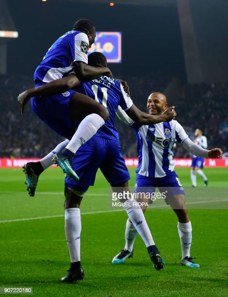 Porto's Malian forward Moussa Marega celebrates a goal with teammates during the Portuguese league football match between FC Porto and CD Tondela at...
