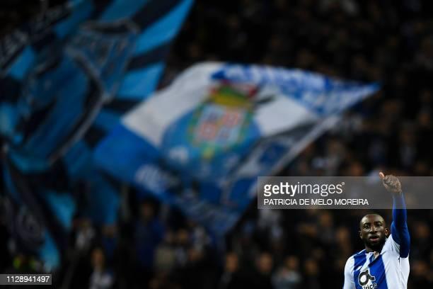 TOPSHOT Porto's Malian forward Moussa Marega celebrates after scoring a goal during the UEFA Champions League round of 16 second leg football match...