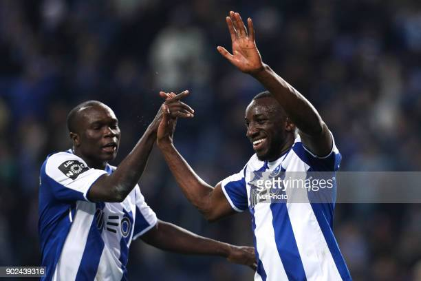 Porto's Malian forward Moussa Marega celebrates after scoring a goal with Porto's Cameroonian forward Vincent Aboubakar during the Premier League...