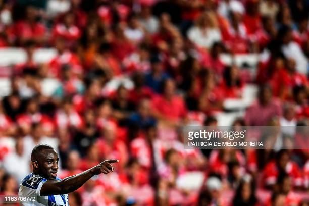 Porto's Malian forward Moussa Marega celebrates after scoring during the Portuguese League football match between Benfica and Porto at the Luz...