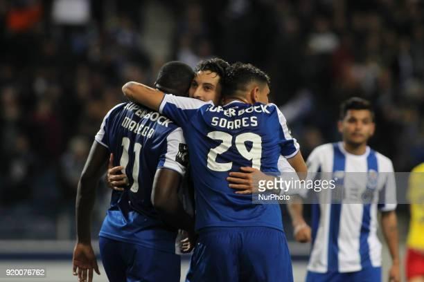 Porto's Malian forward Moussa Marega celebrates after scoring goal with teammate Porto's Brazilian forward Soares and Porto's Brazilian defender Alex...
