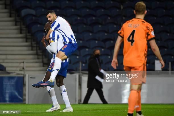 Porto's Malian forward Moussa Marega celebrates his goal with FC Porto's Iranian forward Mehdi Taremi during the UEFA Champions League round of 16...