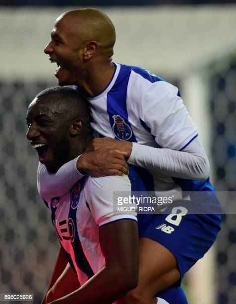 Porto's Malian forward Moussa Marega celebrates with teammate Algerian forward Yacine Brahimi after scoring his second goal during the Portuguese...