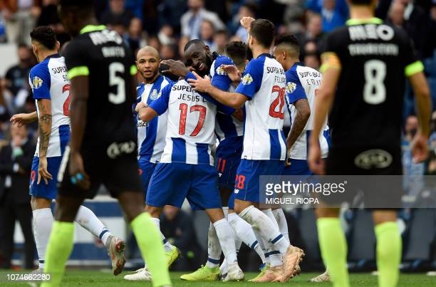 Porto's Malian forward Moussa Marega celebrates with teammates after scoring a goal during the Portuguese League football match between FC Porto and...
