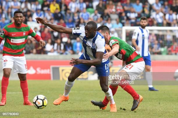 Porto's Malian forward Moussa Marega challenges Maritimo's Portuguese midfielder Joao Gamboa during the Portuguese league football match between...