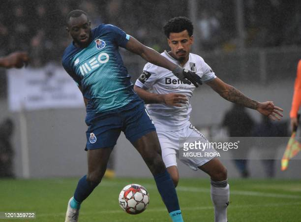 FC Porto's Malian forward Moussa Marega challenges Vitoria Guimaraes' Brazilian forward Welthon during the Portuguese league football match between...