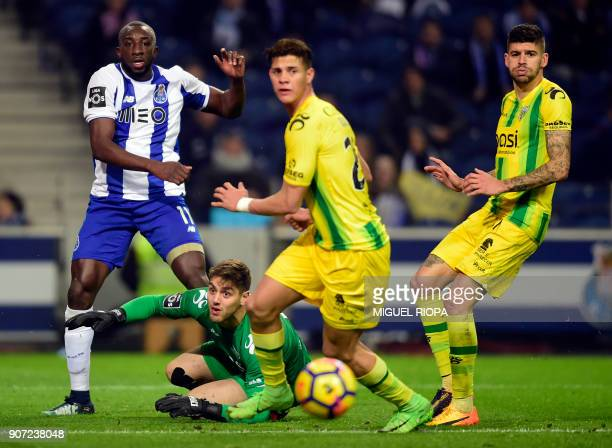 Porto's Malian forward Moussa Marega eyes the ball beside Tondela's Portuguese goalkeeper Claudio Ramos Venezuelan defender Yordan Osorio and...