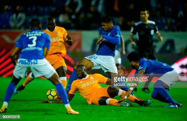 Porto's Malian forward Moussa Marega falls down during the Portuguese league football match CD Feirense vs FC Porto at the Marcolino de Castro...