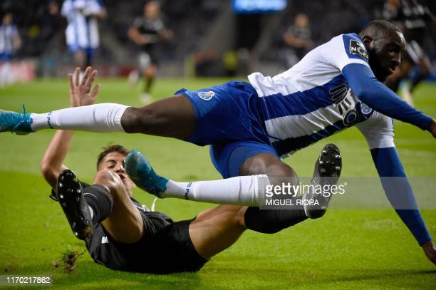 Porto's Malian forward Moussa Marega falls over Santa Clara's Portuguese defender Fabio Cardoso during the Portuguese league football match between...