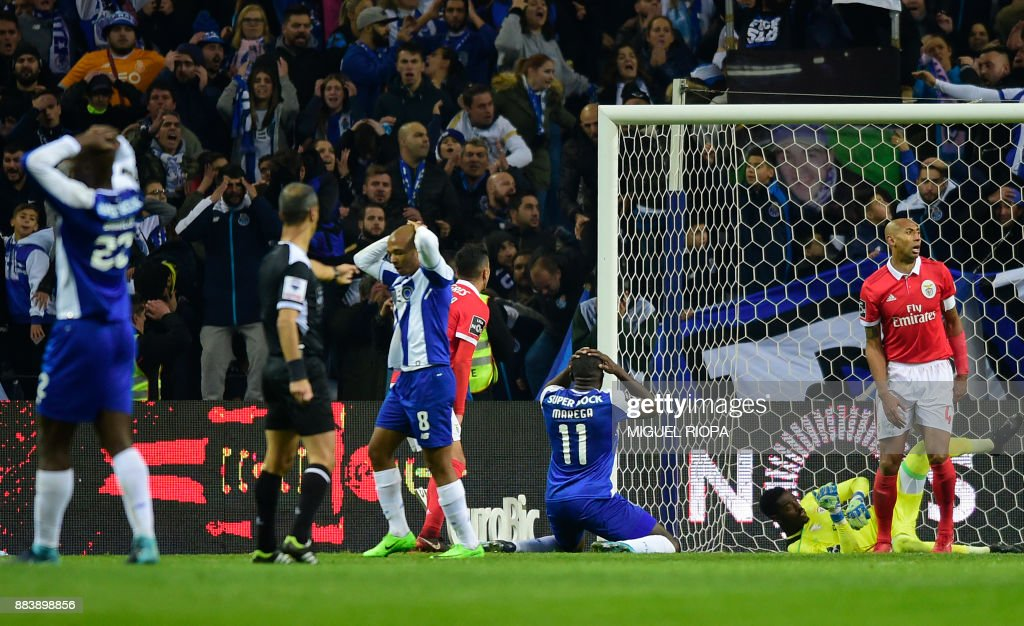 Porto's Malian forward Moussa Marega (C) gestures after missing a goal during the Portuguese league football match FC Porto vs SL Benfica at the Dragao stadium in Porto, on December 1, 2017. /