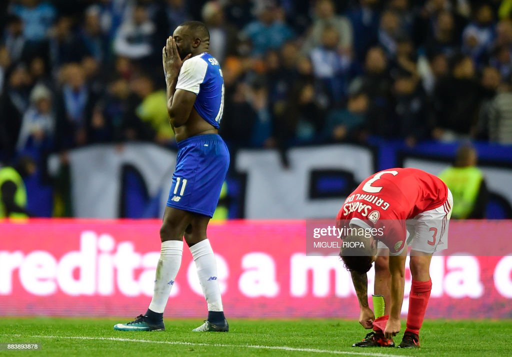 Porto's Malian forward Moussa Marega (L) gestures beside Benfica's Spanish defender Alejandro Grimaldo at the end of the Portuguese league football match FC Porto vs SL Benfica at the Dragao stadium in Porto, on December 1, 2017. /