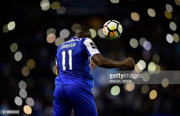 TOPSHOT Porto's Malian forward Moussa Marega heads a ball during the Portuguese league football match between FC Porto and SC Braga at the Dragao...