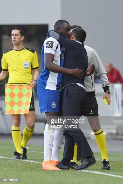 Porto's Malian forward Moussa Marega hugs coach Sergio Conceicao during the Portuguese league football match between Maritimo and Porto at the...