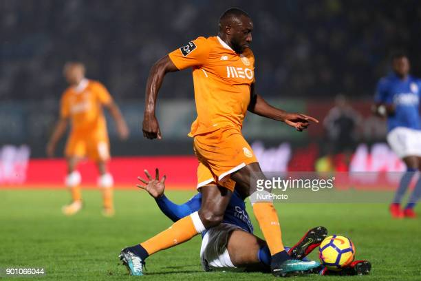 Porto's Malian forward Moussa Marega in action with Feirense's Brazilian defender Flavio Ramos during the Premier League 2016/17 match between CD...