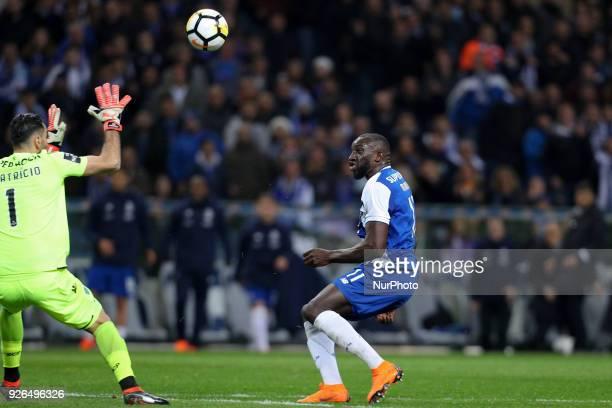 Porto's Malian forward Moussa Marega in action with Sporting's Portuguese goalkeeper Rui Patricio during the Premier League 2017/18 match between FC...