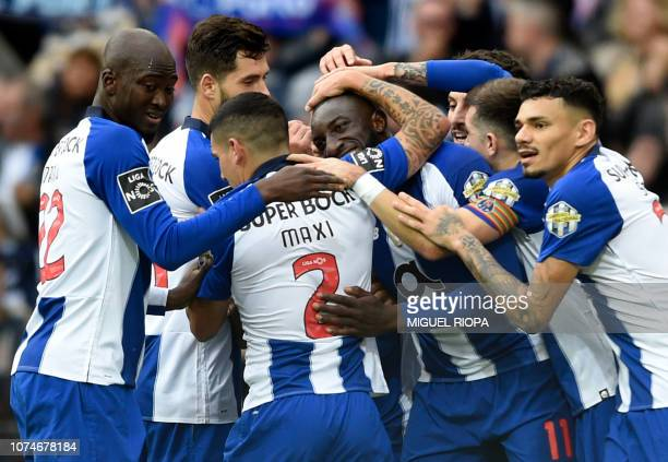 Porto's Malian forward Moussa Marega is congratulated by teammates after scoring a goal during the Portuguese League football match between FC Porto...