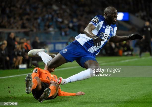 FC Porto's Malian forward Moussa Marega is tackled by Rio Ave's Croatian defender Toni Borevkovic during the Portuguese league football match between...