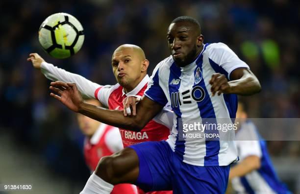 Porto's Malian forward Moussa Marega jumps for a ball with Sporting Braga's Brazilian midfielder Raul Silva during the Portuguese league football...