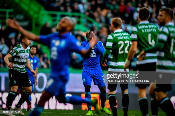 Porto's Malian forward Moussa Marega reacts after missing a goal opportunity during the Portuguese League football match between Sporting CP and FC...